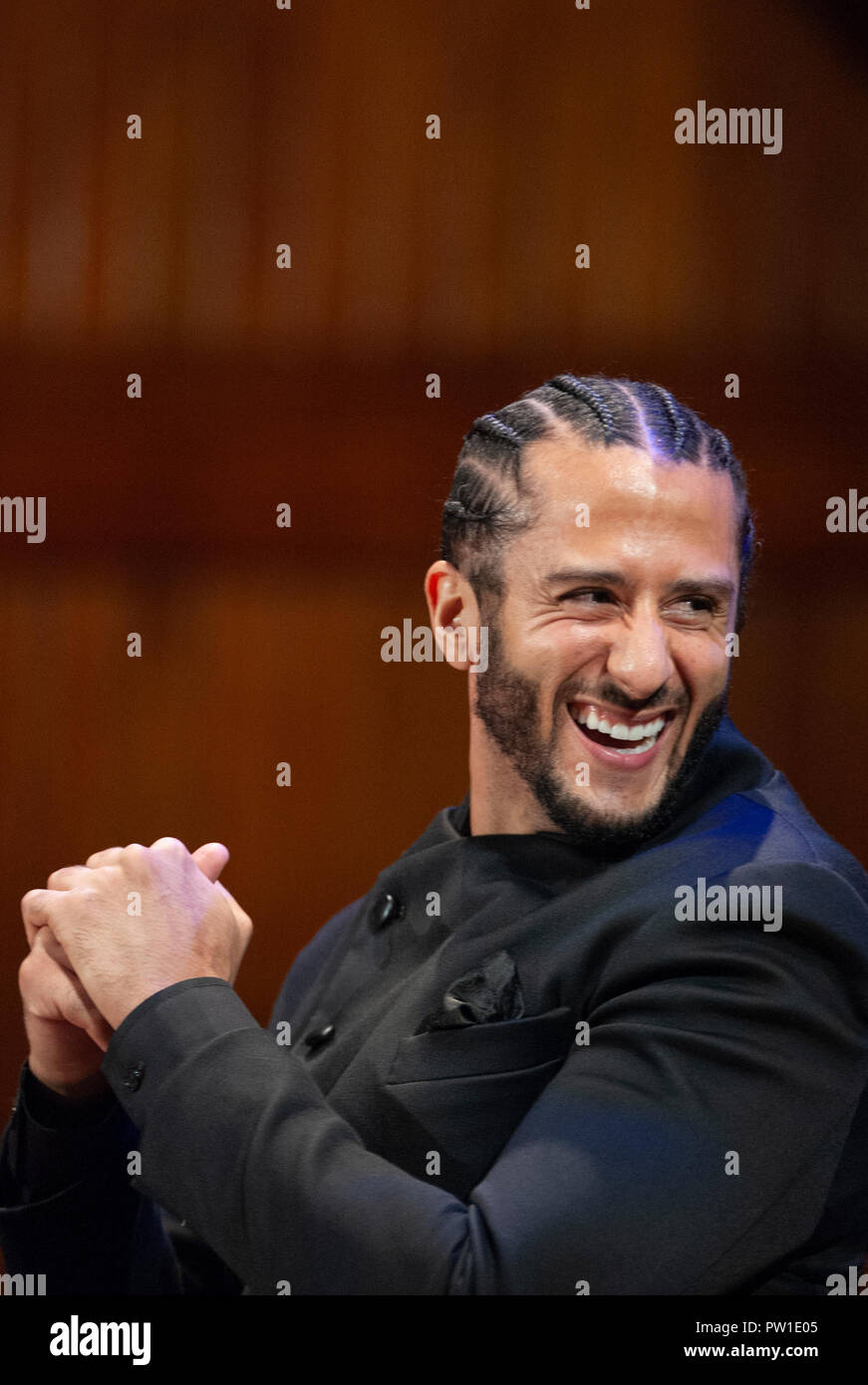 Hutchins Center, Harvard University, Cambridge, MA, USA. 11th Oct 2018. Colin Kaepernick during the 2018 W.E.B. Du Bois medal ceremony at Harvard University in Cambridge, Massachusetts, USA.   Kaepernick, a former NFL quarterback for  the San Francisco 49ers became an American icon after keeling during the U.S. National anthem in protest of Police violence against black Americans. Credit: Chuck Nacke/Alamy Live News - Stock Image