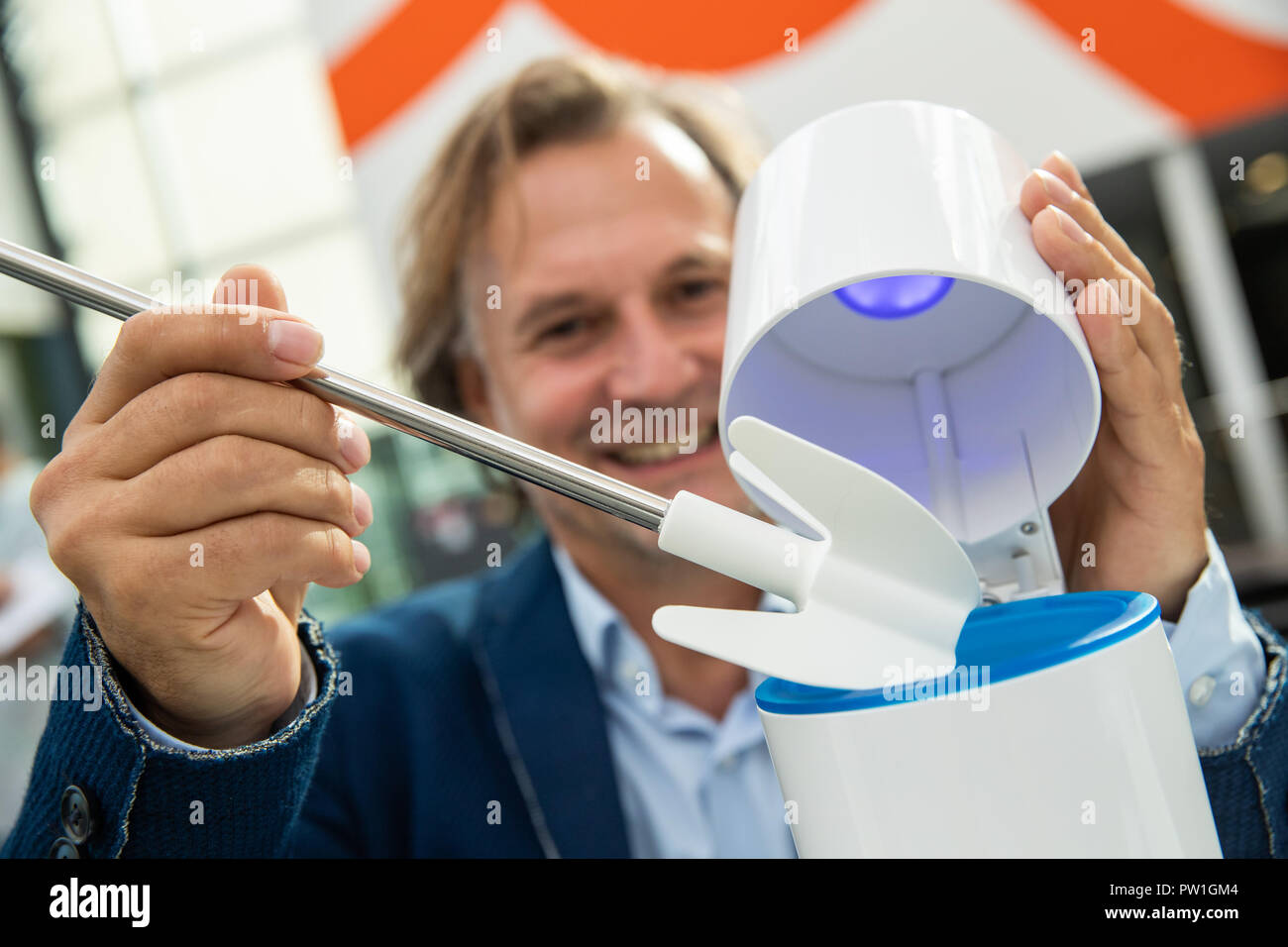 Nuremberg, Bavaria. 12th Oct, 2018. Jochen Schmiddem, product designer, presenting a silicone toilet brush during the innovation show at the International Inventors' Fair 'iENA', which is almost completely free of germs and bacteria in its closed container by UV-C irradiation. The fair celebrates its 70th anniversary this year and will take place from 1 to 4 November in Nuremberg. Credit: Daniel Karmann/dpa/Alamy Live News - Stock Image