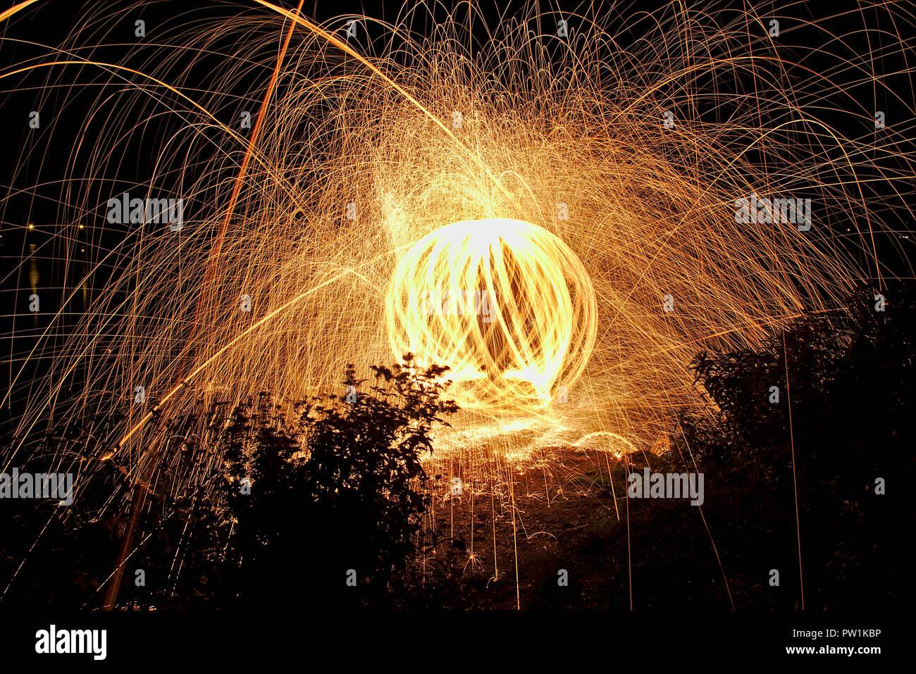 light painting, fireball by night - Stock Image