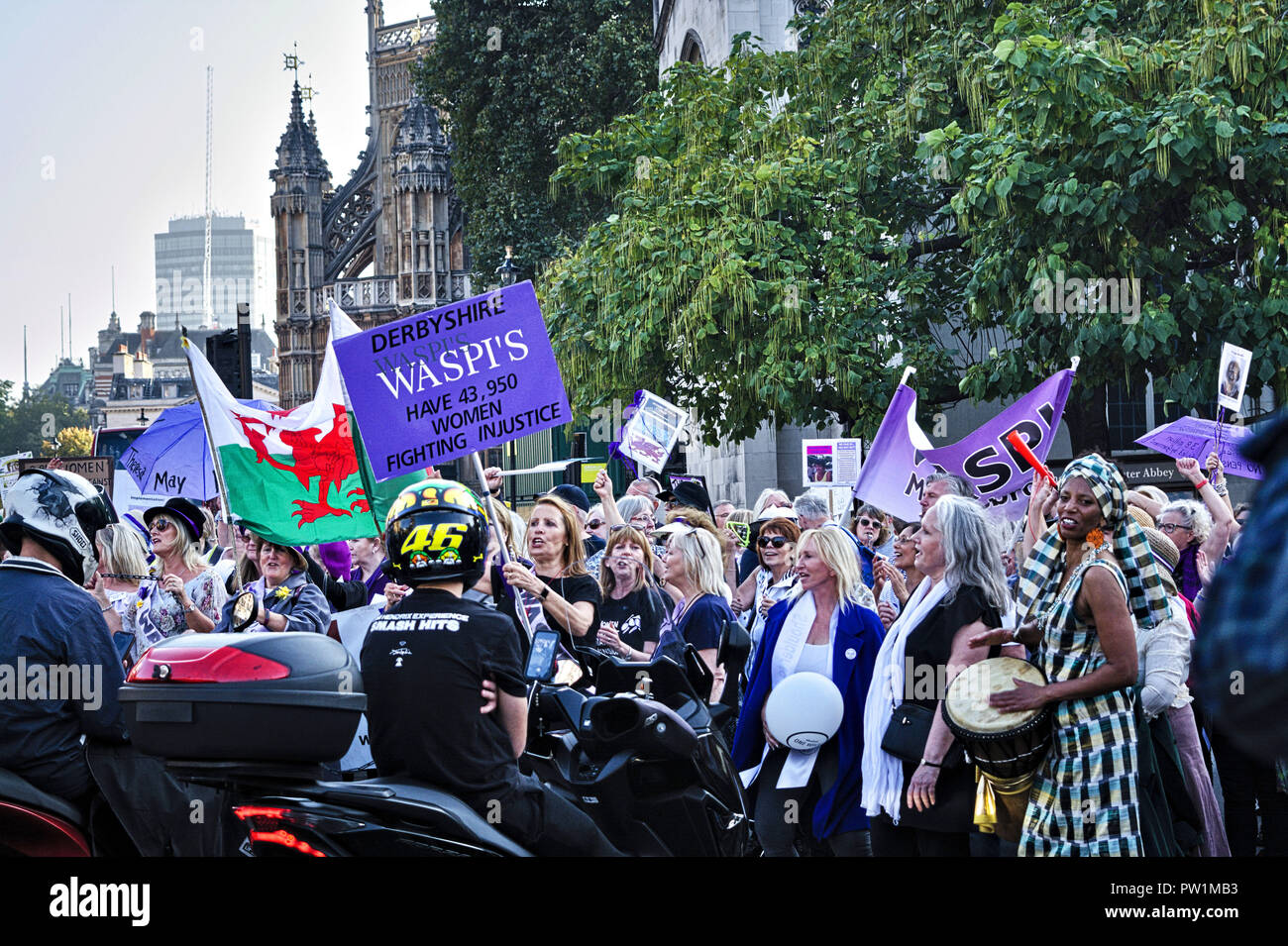 London, Women Against State Pension Inequality group campaign. Protesters block road outside Parliament. - Stock Image
