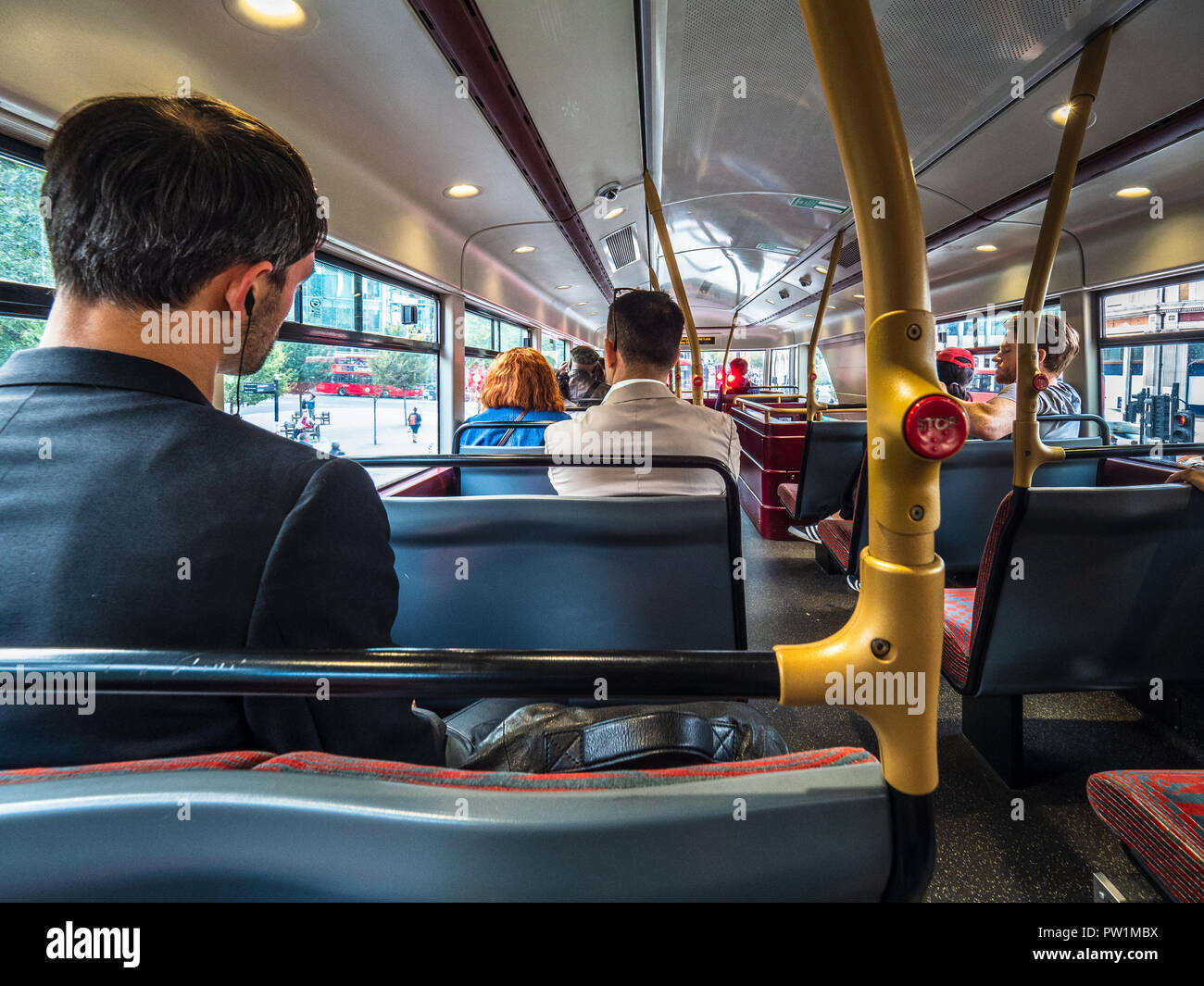 London Routemaster Bus Top Deck - passengers on the top deck of a new model London Routemaster bus - Stock Image
