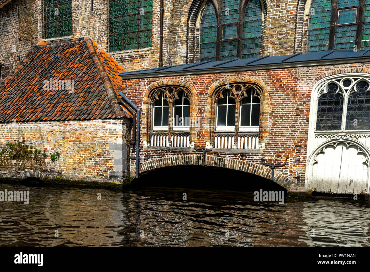 the canal at Brugge, Belgium across an arch - Stock Image