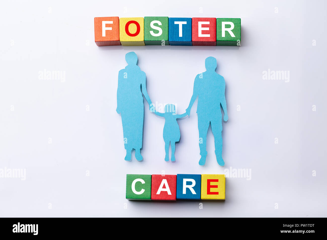 Multi Colored Foster Care Cubic Blocks With Family Figures On White Background - Stock Image
