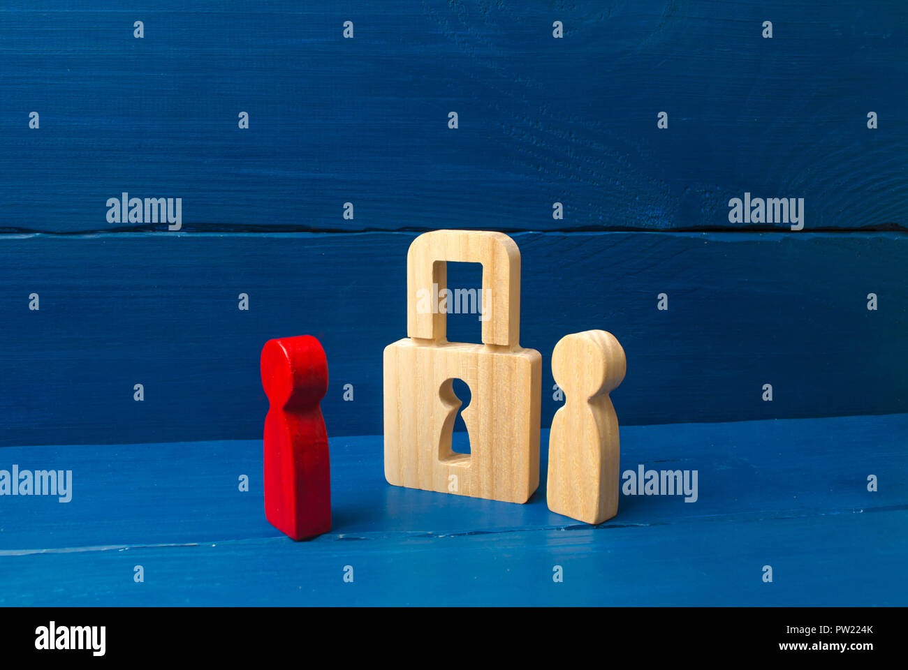The person stands near the padlock and protects him from the red person. concept of the preservation of secrets, information and values. Protection of - Stock Image