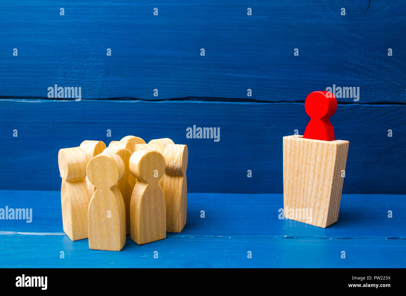 Business concept of leader and leadership qualities, crowd management, political debate and elections. Business management. Red leader from the rostru - Stock Image