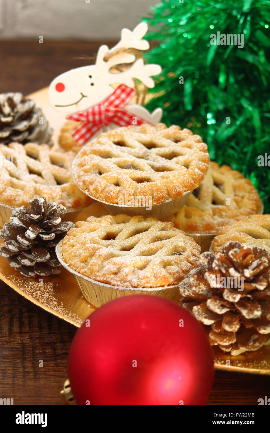 Christmas mince pies on a gold plate  on  wooden background - Stock Image