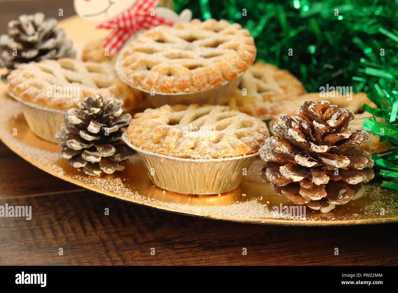 Christmas mince pies on a wooden background - Stock Image