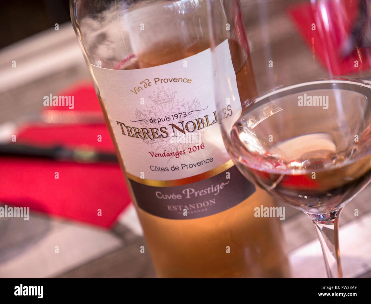 Rosé wine bottle with glass on restaurant able Terres Nobles Côtes de Provence Cuvée Prestige Estandon Vendanges 2016 Brittany France - Stock Image