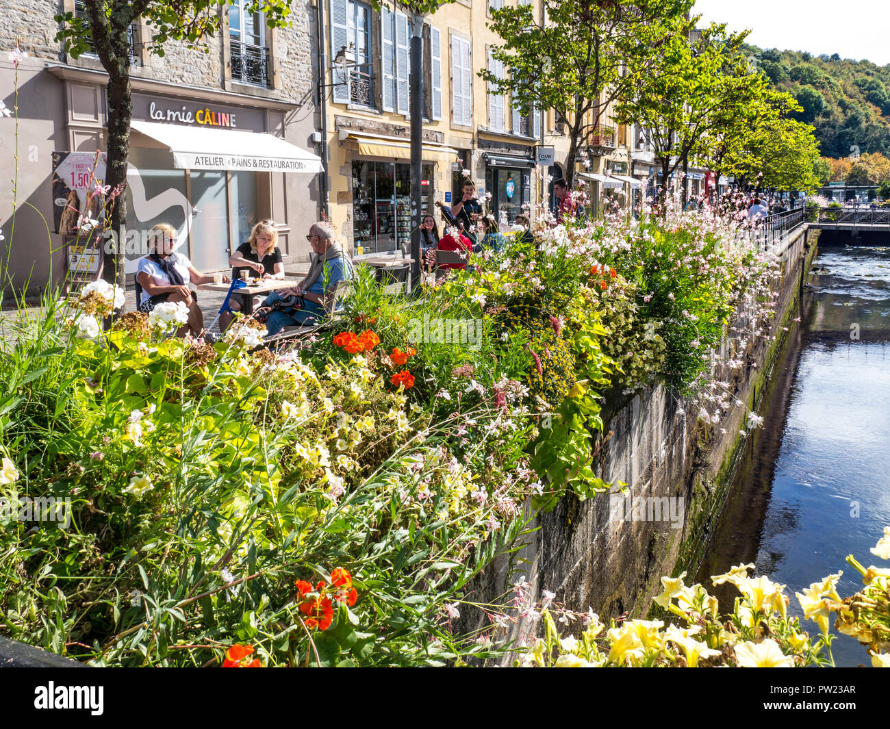 Quimper alfresco café outside the Halles covered organic market, floral sunny summer River Odet Quimper Brittany France - Stock Image