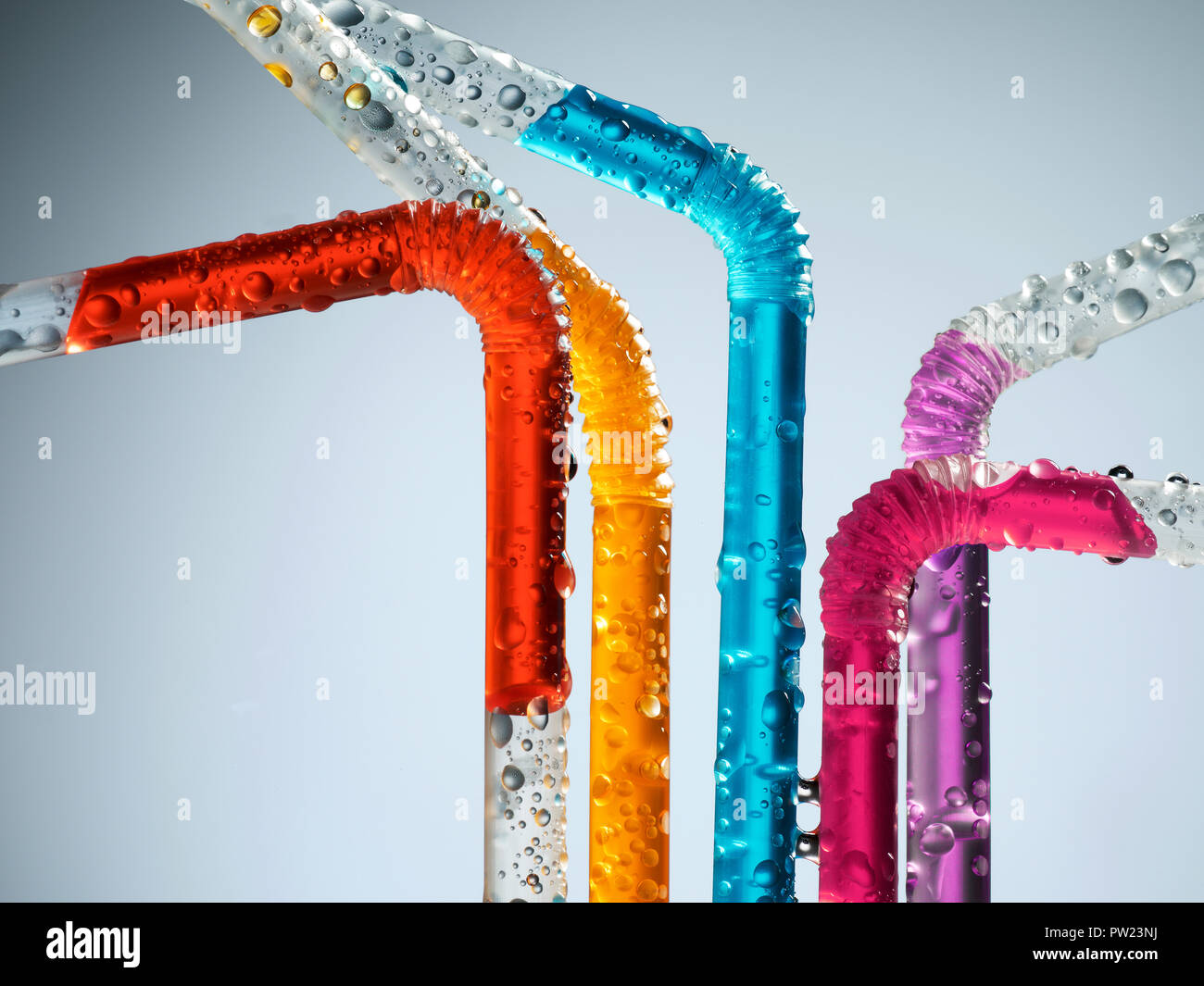 A Group of colored Straws with colorful Liquids, Summer Fun, Cheerful - Stock Image