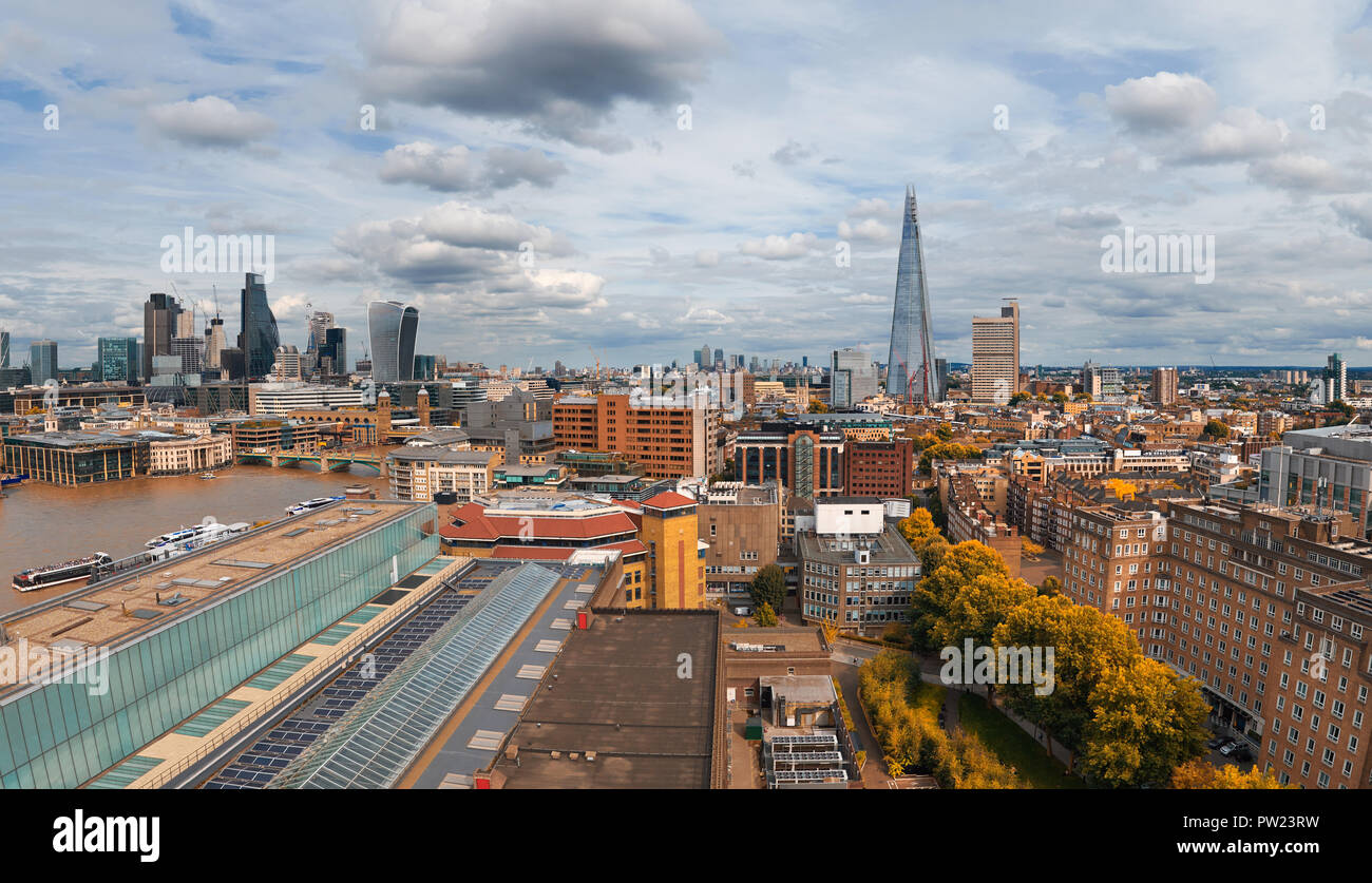 Panoramic aerial view with the Shard, skyscrapers of the City of London and London skyline on a gloomy overcast day in Autumn, toned image - Stock Image