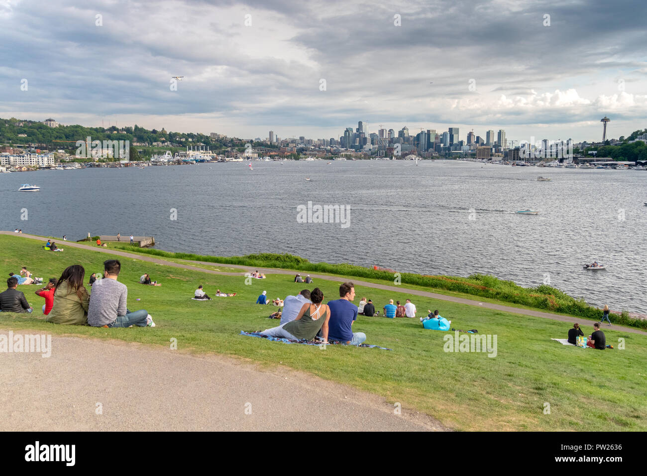 SEATTLE, WA, MAY 6, 2018: Dozens of people visit Gas Works Park to view Seattle's skyline across Lake Union. - Stock Image