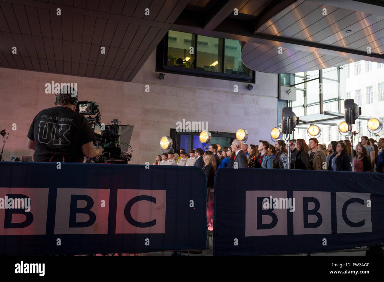 A BBC cameraman operates his equipment during a rehearsal for an outside broadcast for the One Show at Broadcasting House, on 4th October 2018, in London, England. - Stock Image