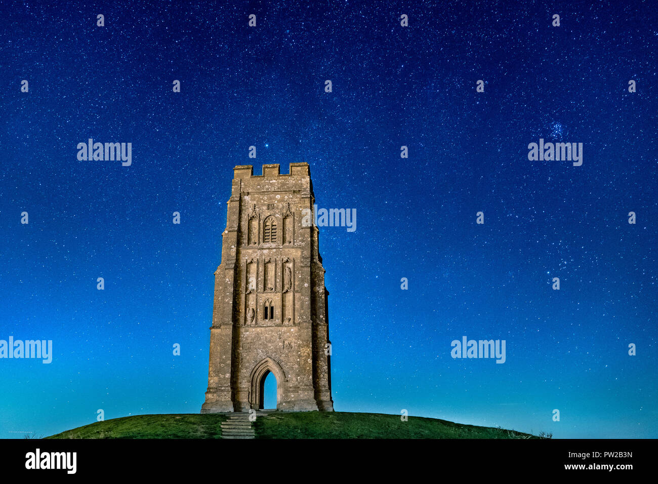 Glastonbury Tor at Night with Many Stars in the Sky - Stock Image