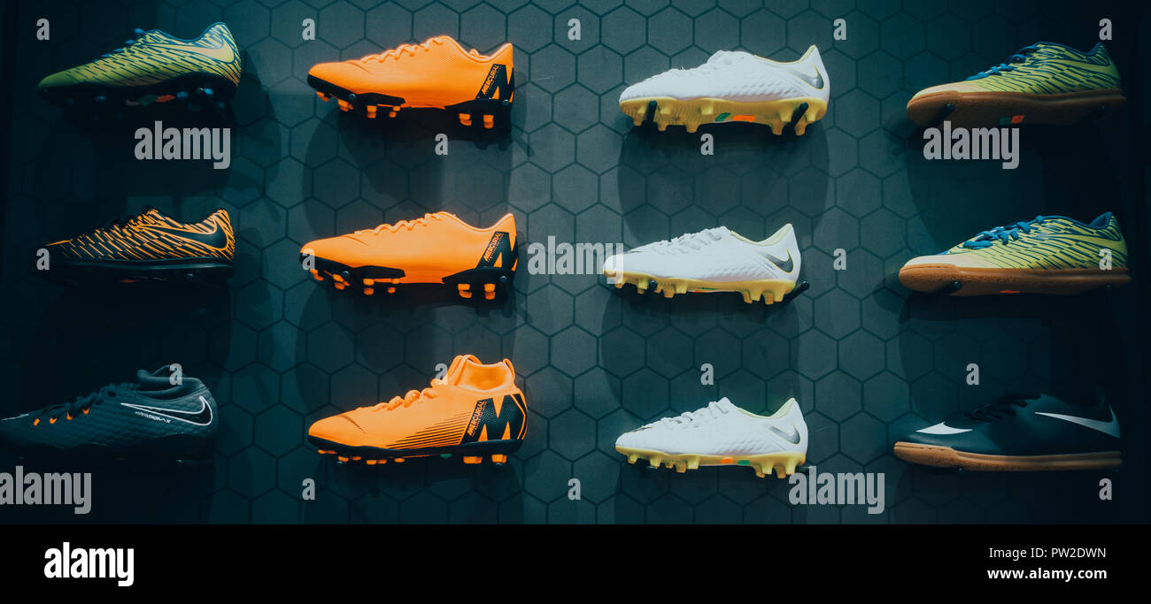 d0ff68b18 Nike football boots displayed on black background in sport store - Stock  Image