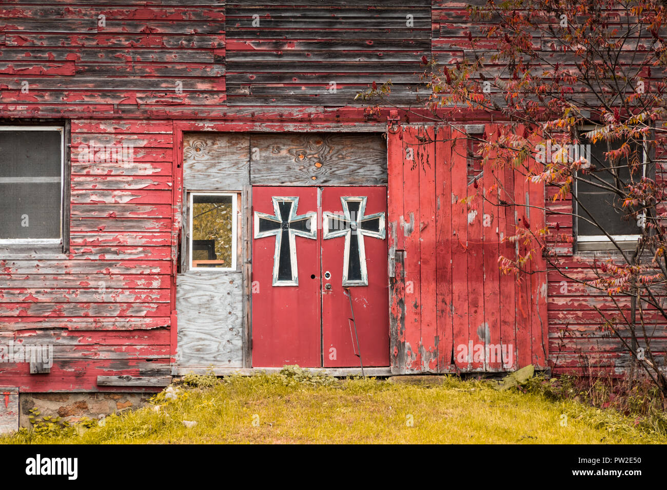 Red Barn Double Doors Are Adorned In Large Gothic Style Crosses