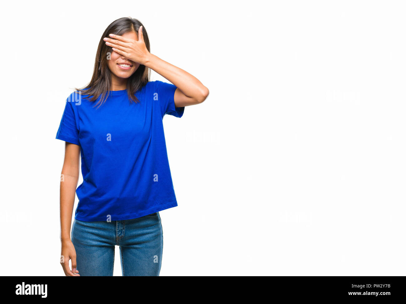 Young asian woman over isolated background smiling and laughing with hand on face covering eyes for surprise. Blind concept. - Stock Image