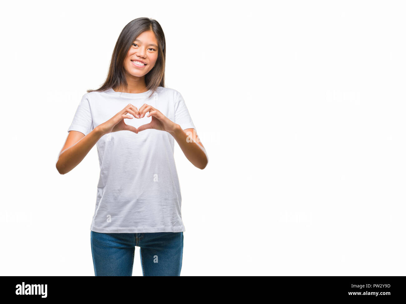 Young asian woman over isolated background smiling in love showing ...