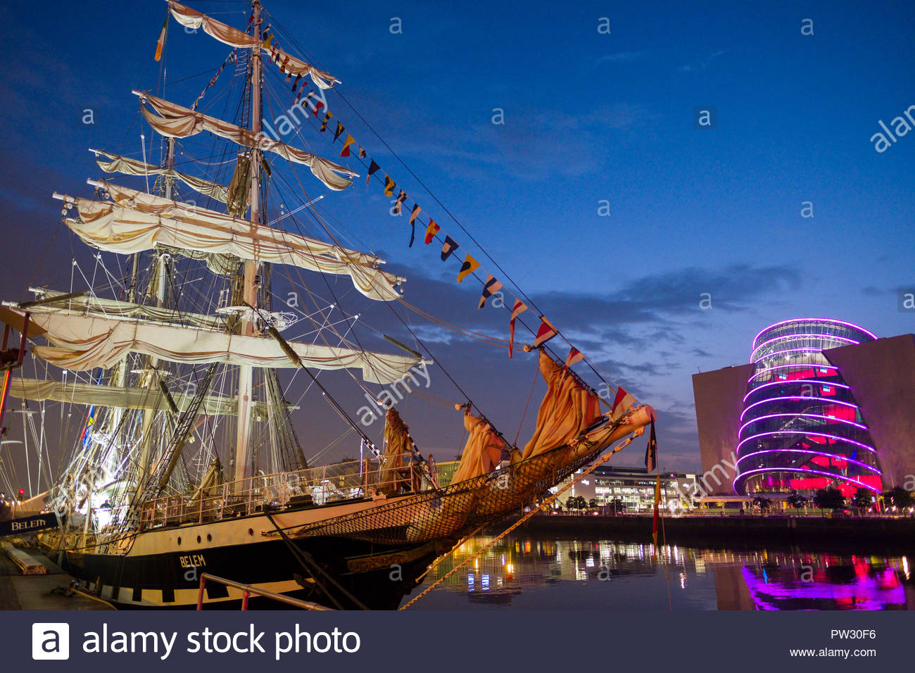 The tall ship Belem docked along the River Liffey at night during the 2018 Tall Ships Regatta, Docklands, Dublin, Leinster, Ireland - Stock Image