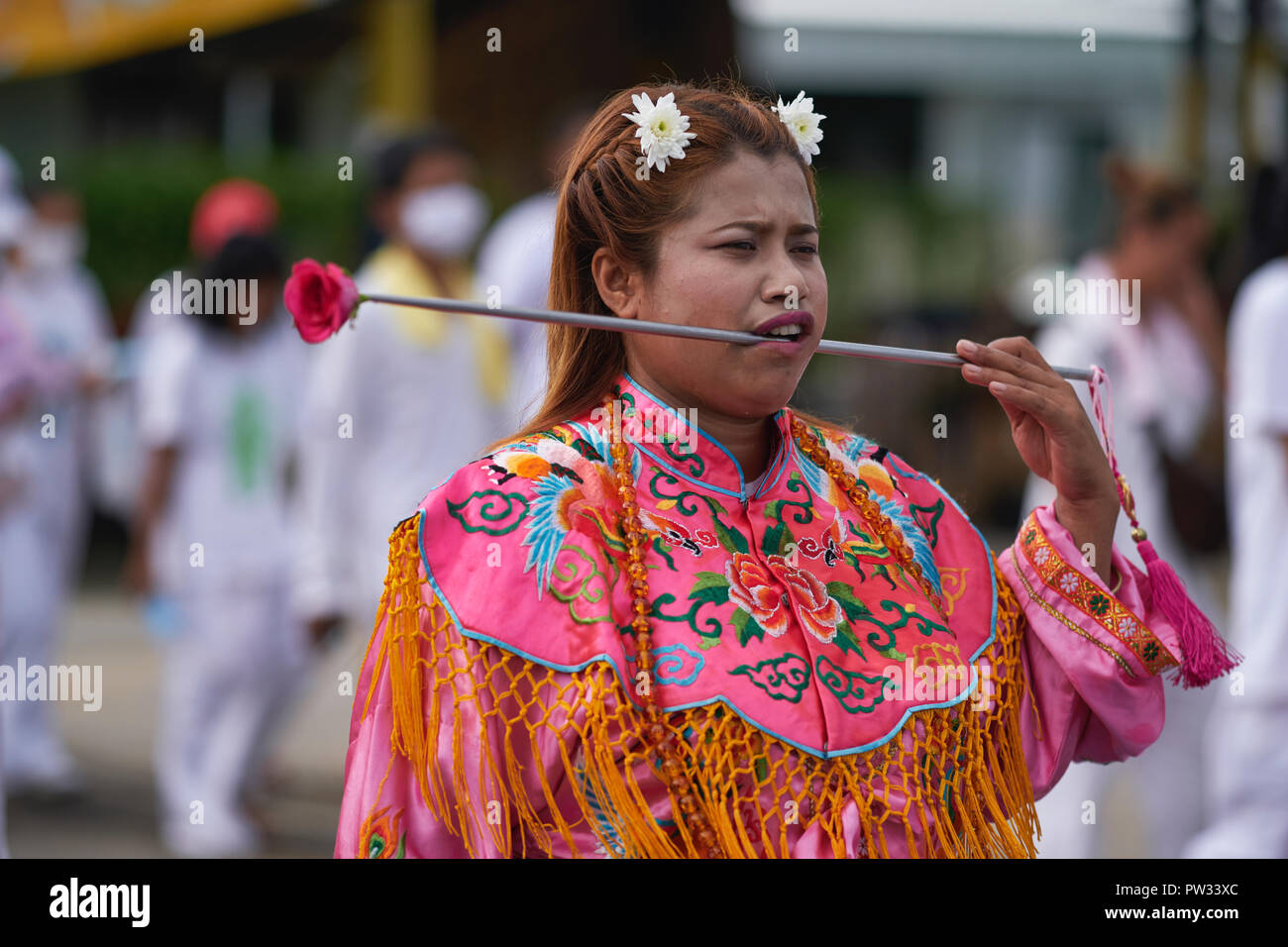 During the Vegetarian Festival in Phuket, a woman in traditional Chinese dress takes on the role as spirit medium - Stock Image