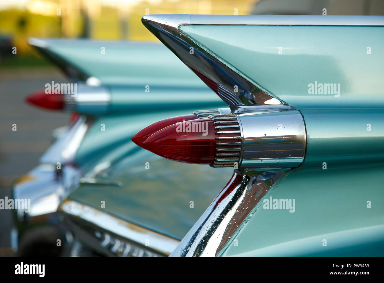 Tail fins with red tail lights of an american vintage car, Cadillac de Ville 1959, Canada - Stock Image