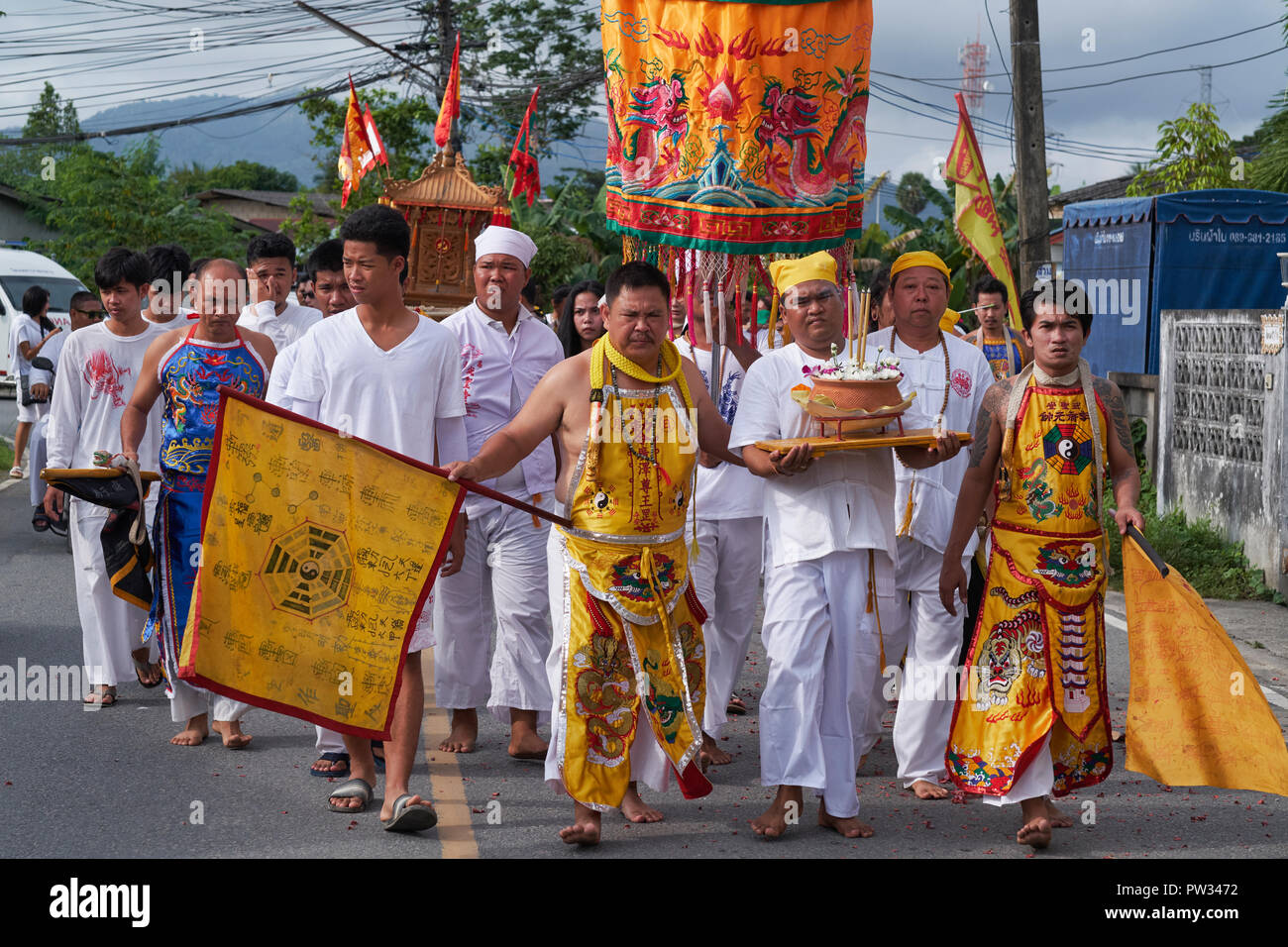 A street procession during the annual Vegetarian Festival in Phuket, Thailand, during which some participants pierce their bodies with strange objects Stock Photo