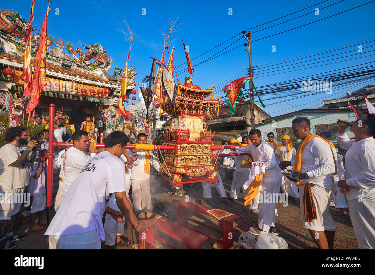 A street procession during the annual Vegetarian Festival in Phuket, Thailand, here starting out at the Chinese temple in Sapam north of Phuket Town - Stock Image