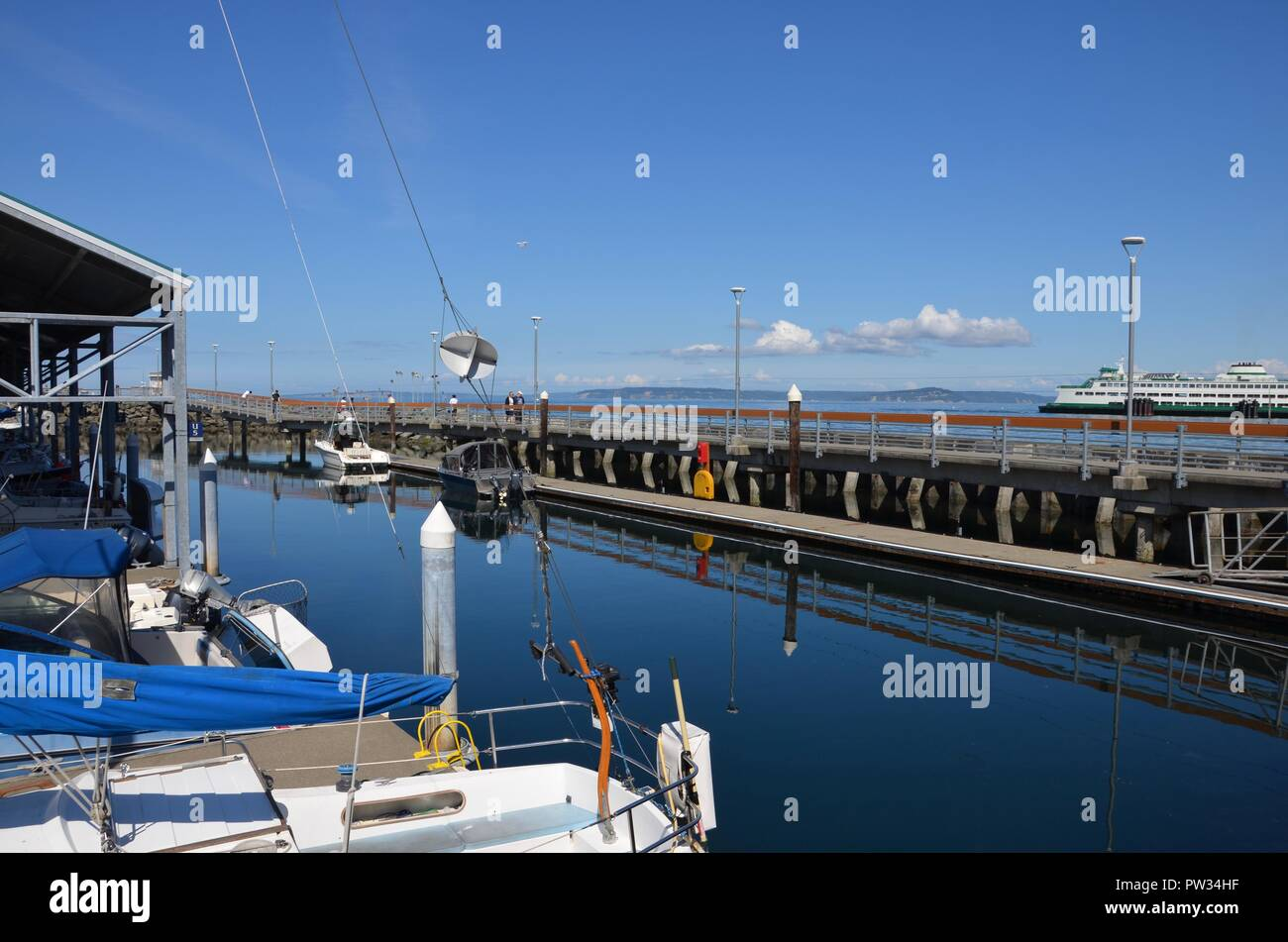 Harbor of Edmonds in Washington state, Pacific coast, fishing, boats, state ferry route, September, blue sky, cloudy, sunny - Stock Image