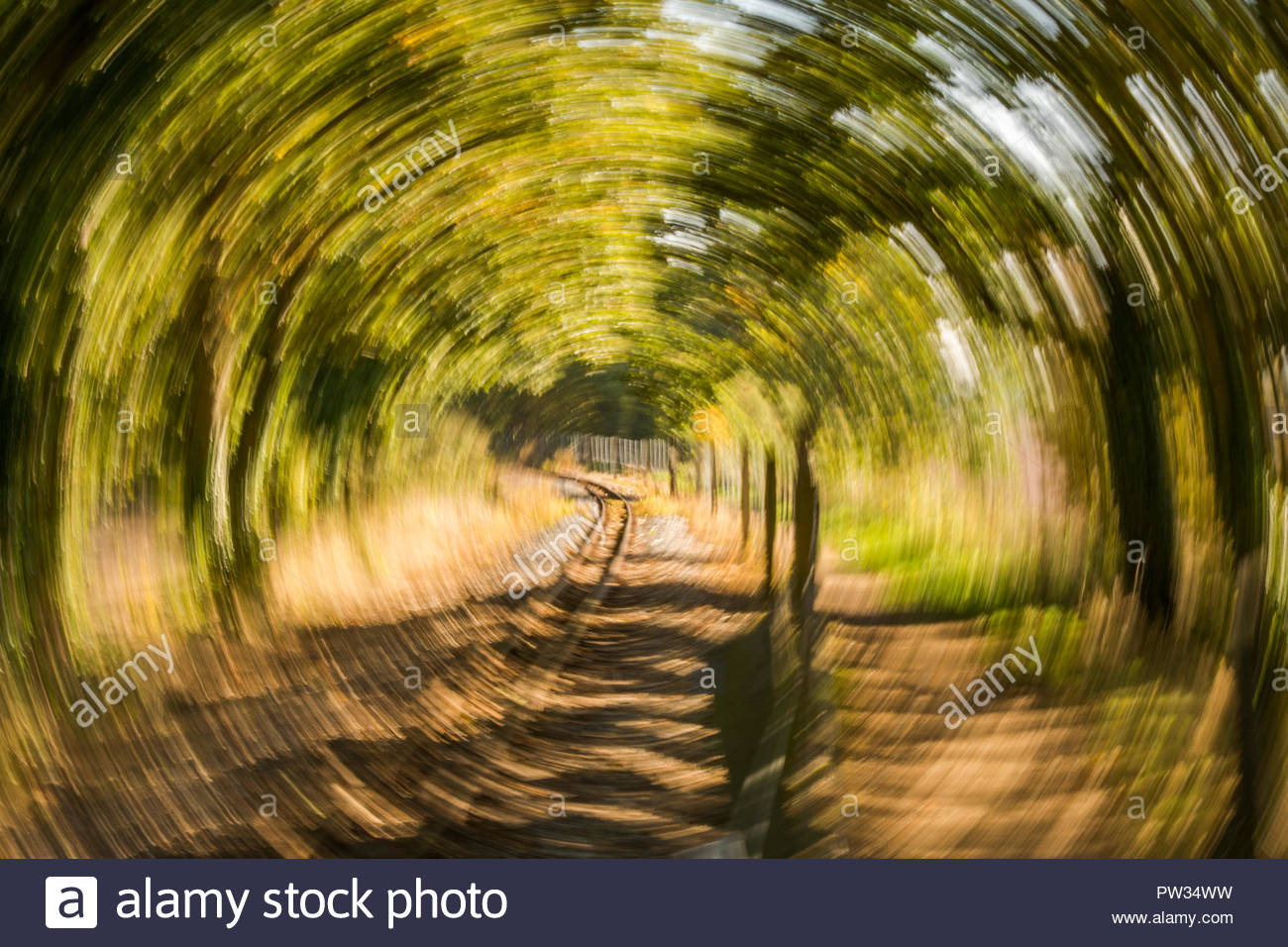 Railway track with rotation blur - Stock Image