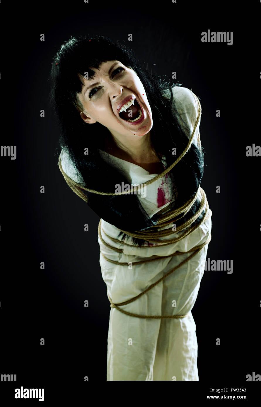 Halloween horror  Crazy bloody scary zombie vampire woman