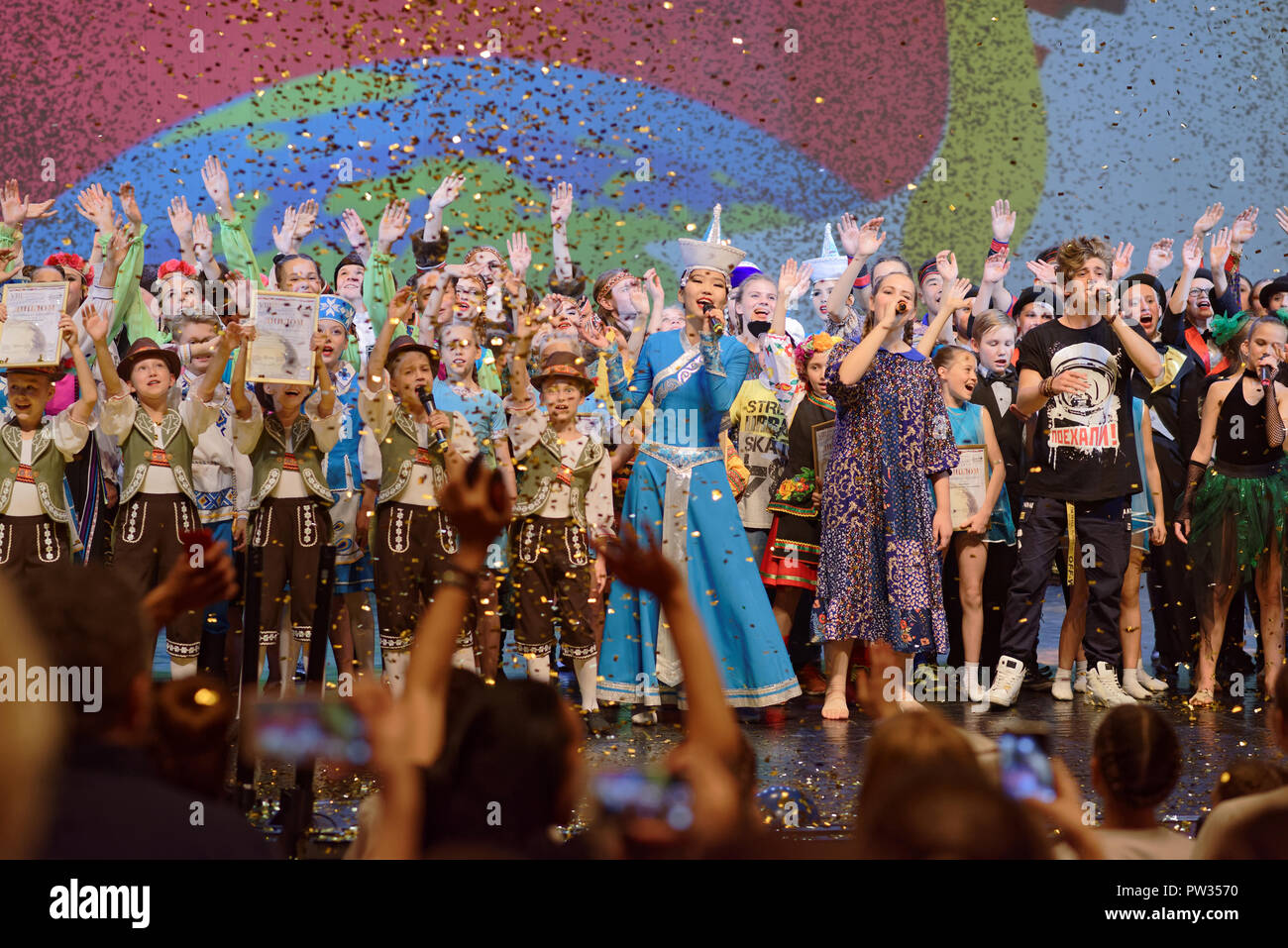 St. Petersburg, Russia - October 8, 2018: Participants of the super final of International project 'Fireworks of talents. Choreography' singing the hy - Stock Image