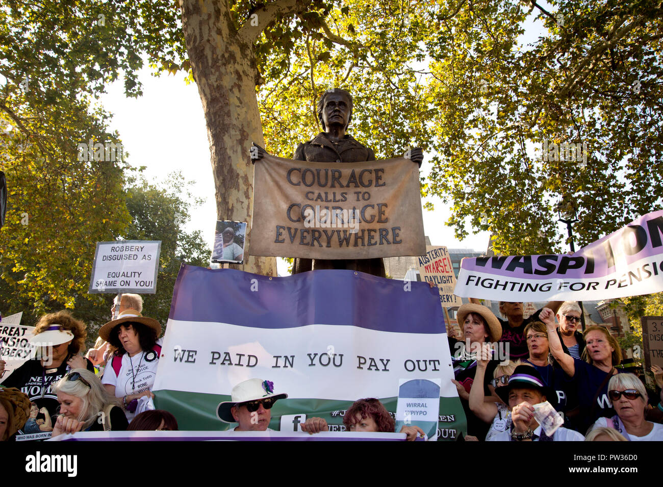 Women protest in Parliament Square by the statue of suffragette leader Millicent Fawcett over change in pension age from 60 for women born in 1950s - Stock Image
