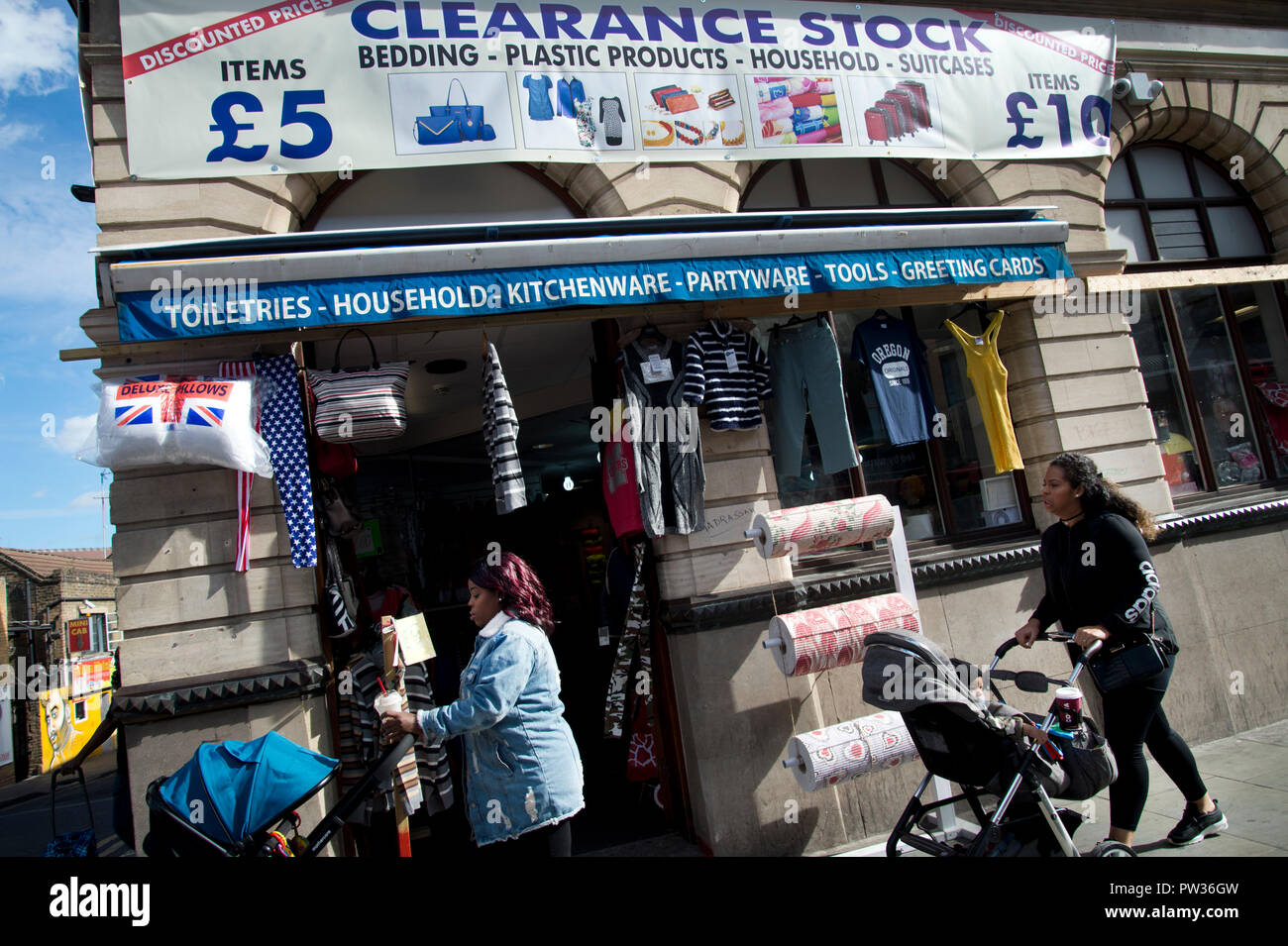 Hackney. Kingland High Street. Ex Nat West Bank, now a discount/clearance shop. - Stock Image