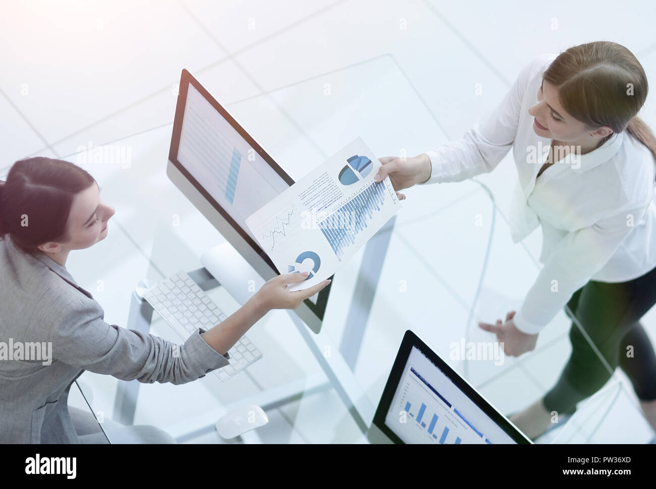 senior Manager conveys to the employee the financial document - Stock Image