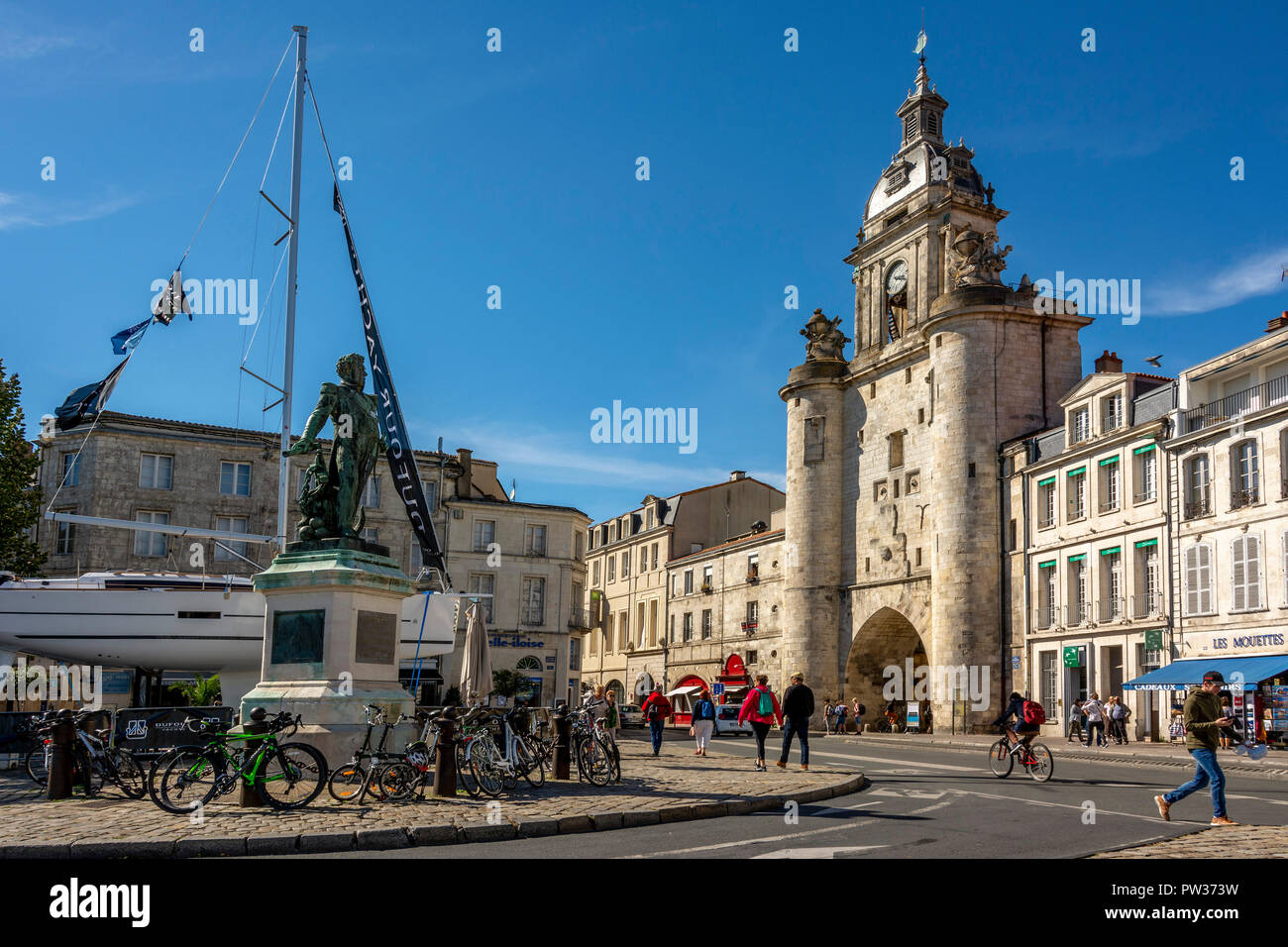 Statue of Admiral Duperré and The great Clock Tower of la Rochelle, Charente Maritime, Nouvelle Aquitaine, France - Stock Image