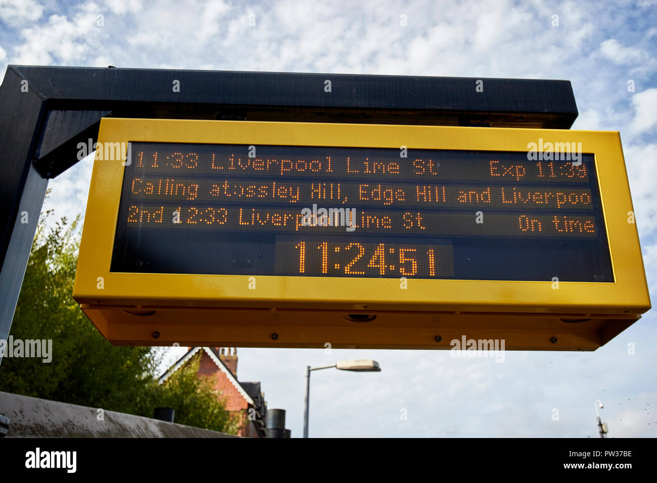train information electronic board at hunts cross train railway station Liverpool Merseyside England UK - Stock Image