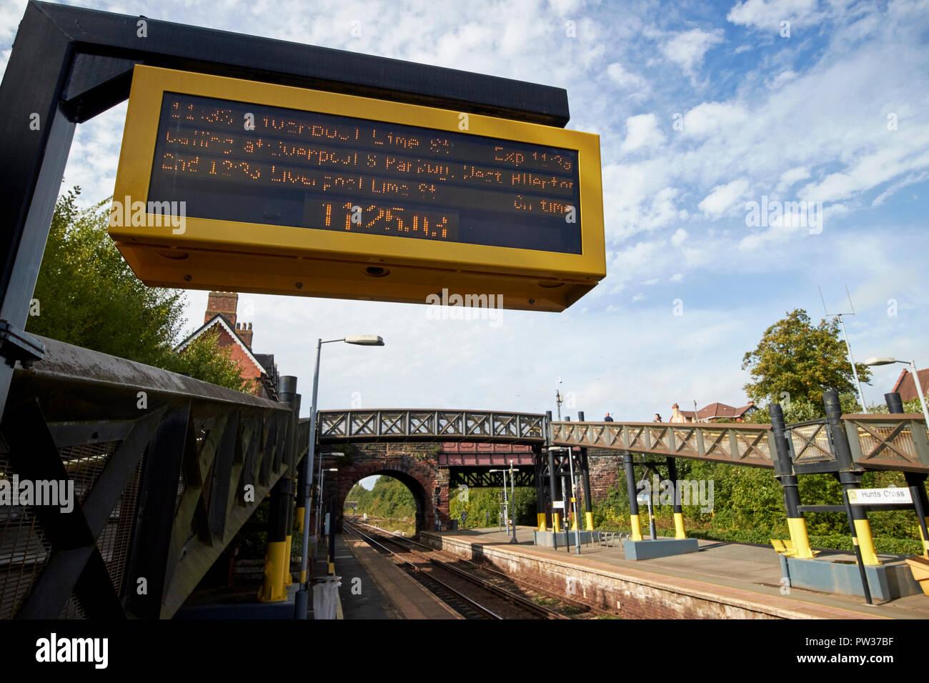 train information electronic board at hunts cross train railway station Liverpool Merseyside England UK - Stock Image