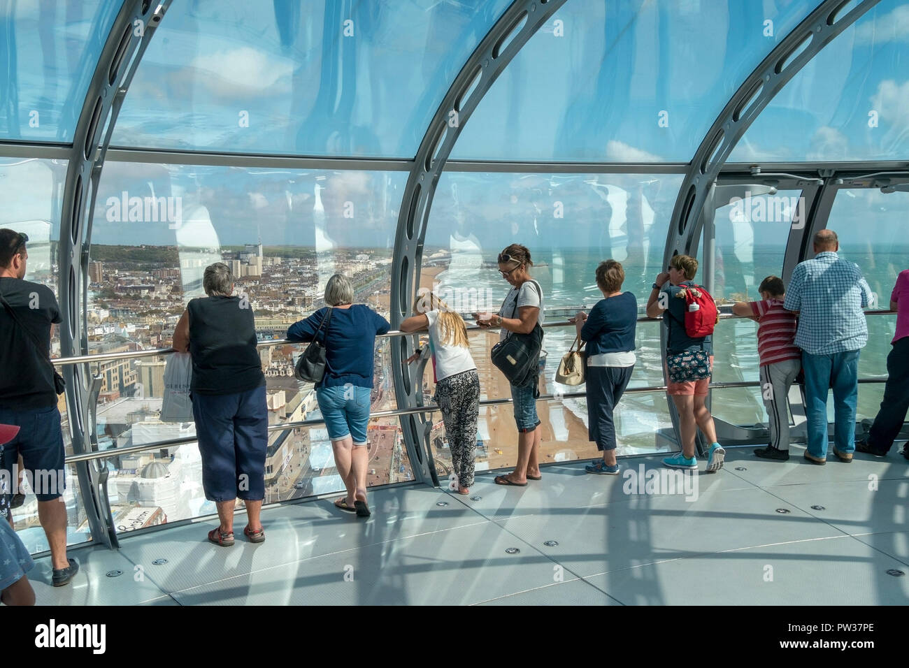 Sightseers looking at the view from British Airways i360 observation pod, Brighton, East Sussex, England, UK - Stock Image