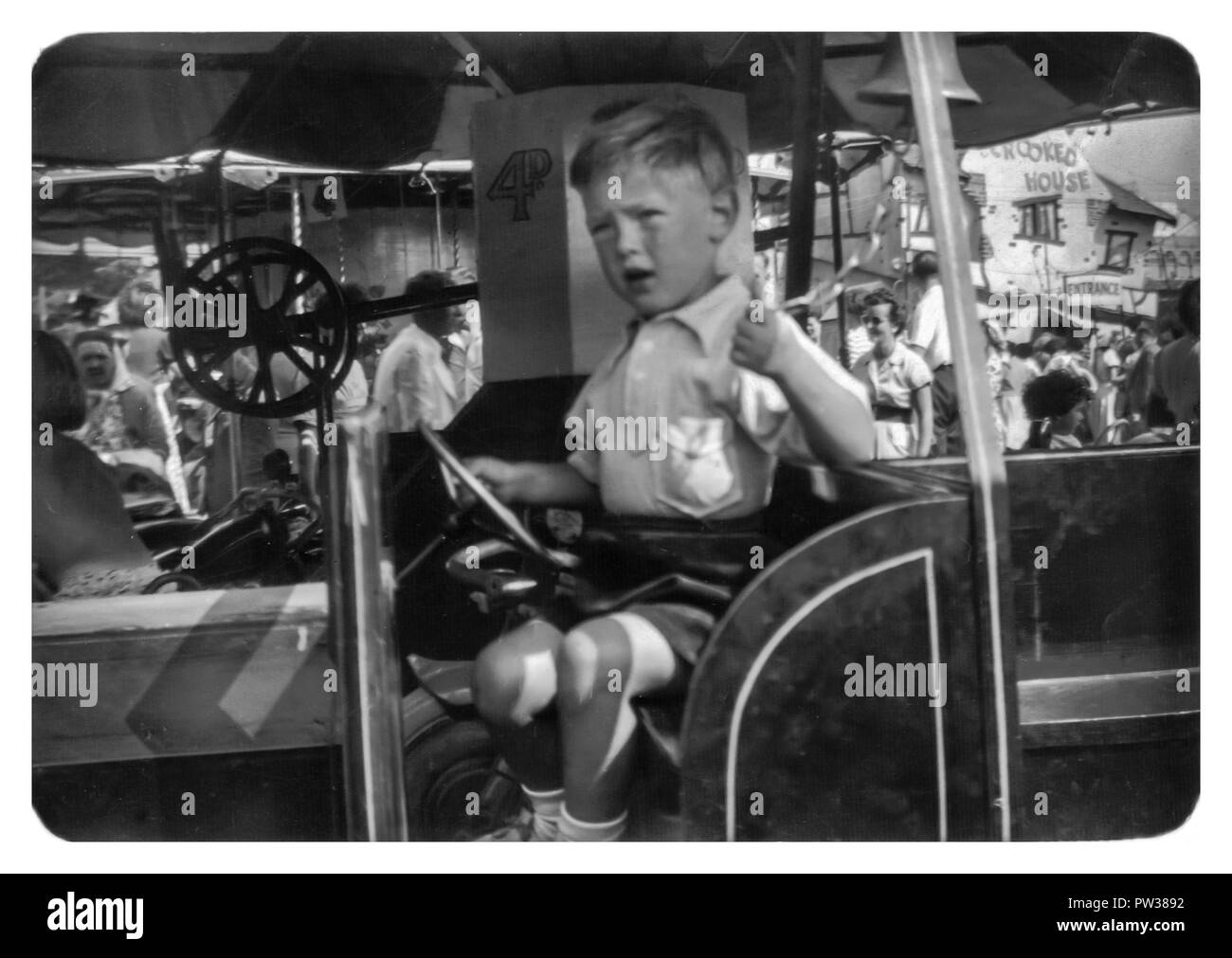 Young Caucasian boy aged 4 on a merry go round, Southend on sea Essex England UK, 1956 - Stock Image