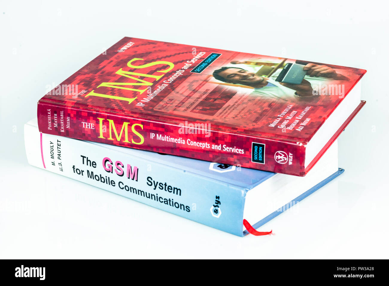 Technical reference books on Mobile technologies covering GSM and IMS - Stock Image