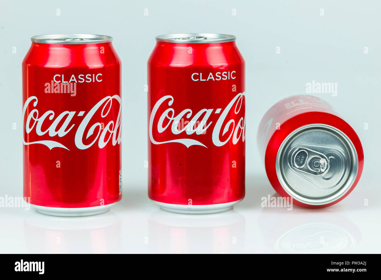 Classic Coke cans by Coca Cola isolated on white background - Stock Image