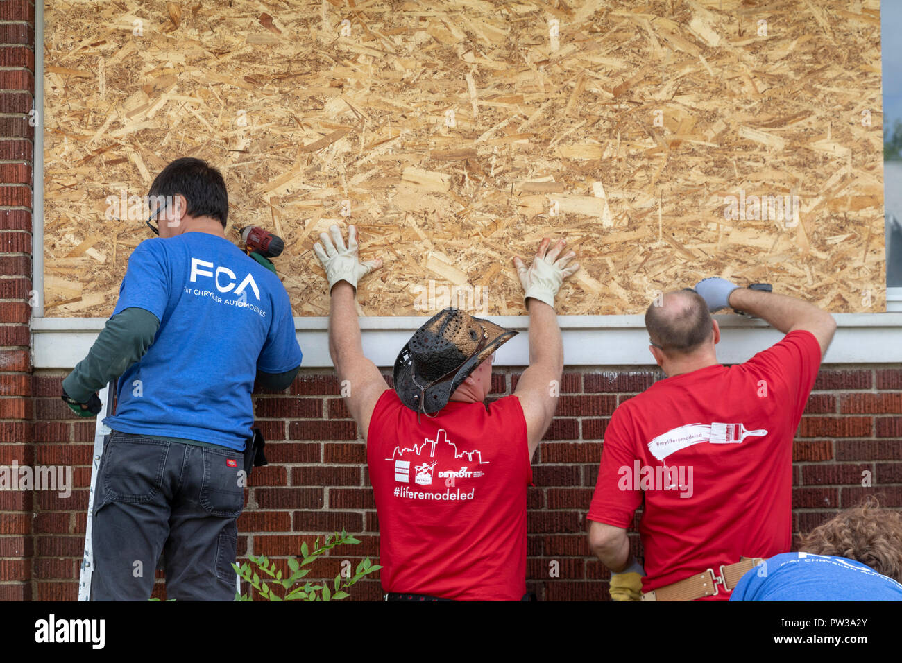 Detroit, Michigan - Volunteers clean up a distressed neighborhood during a week-long community improvement initiative called Life ReModeled. Volunteer Stock Photo