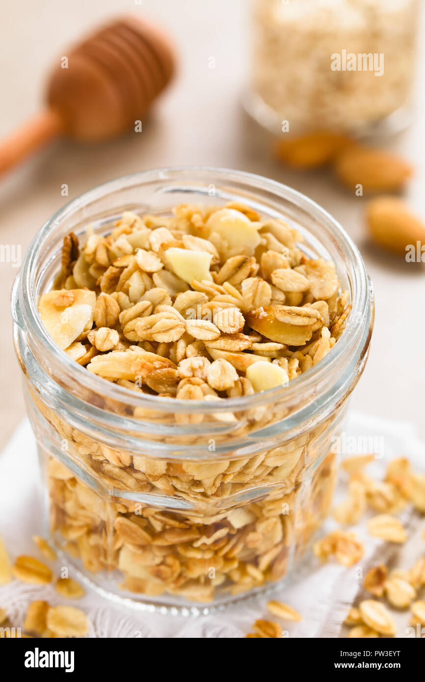 Homemade baked crunchy oatmeal, sliced almond, honey and