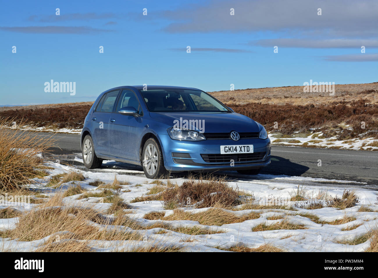 VW Golf TDi in snow - Stock Image