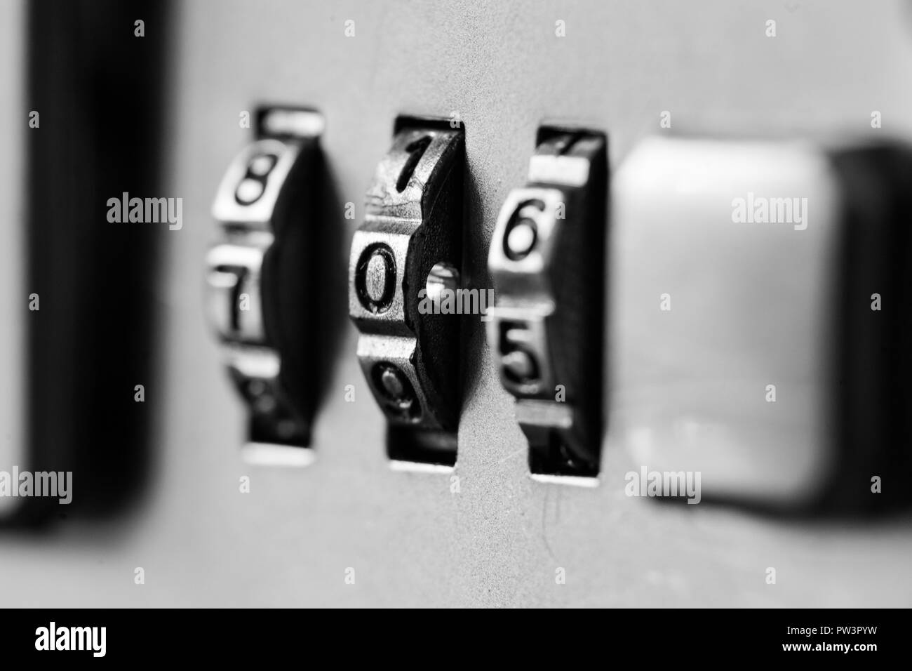 Combination padlock close up with chrome numbers. Mechanical combination lock, counter. Selective focus - Stock Image