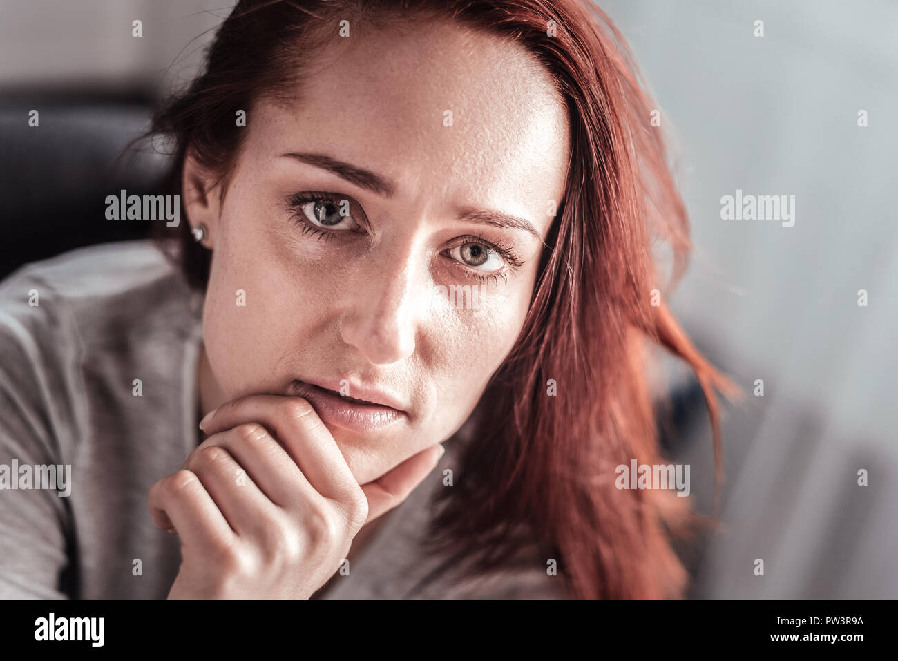 Portrait of a depressed thoughtful woman - Stock Image