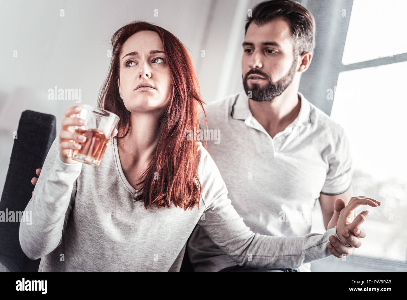 Nice unhappy woman turning away from her boyfriend - Stock Image