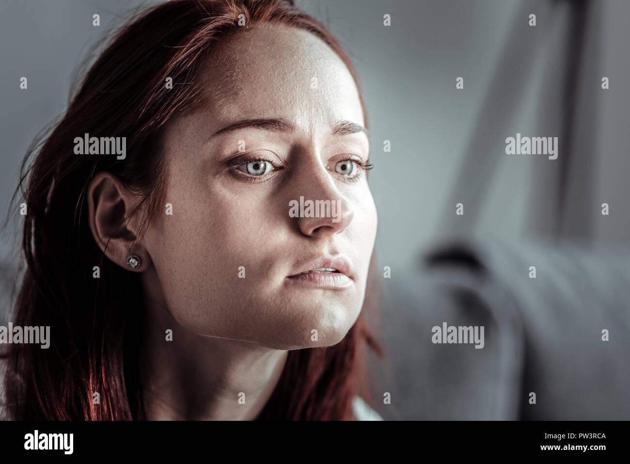 Thoughtful female person having depressive mood - Stock Image
