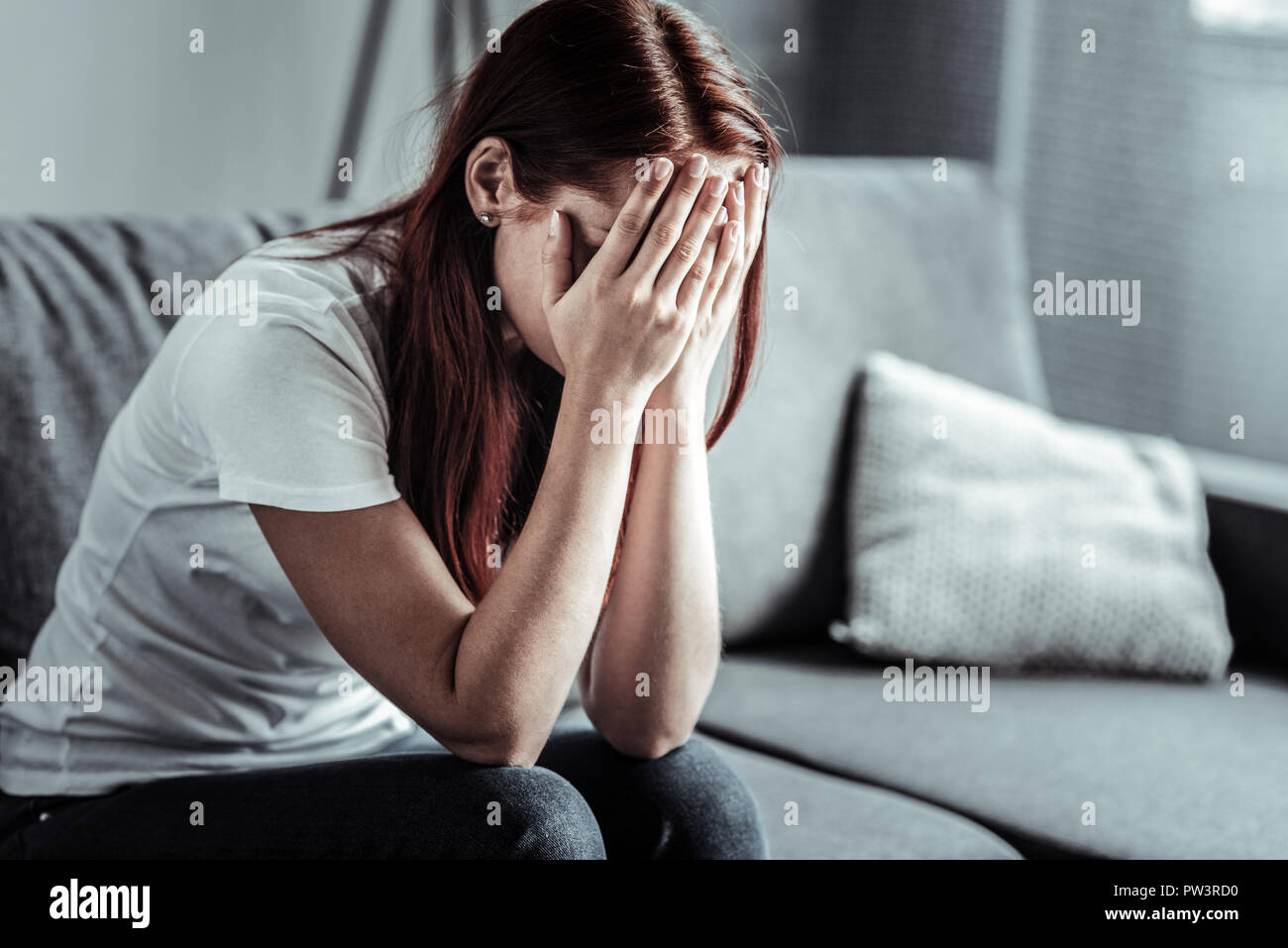Upset girl being in deep depression - Stock Image