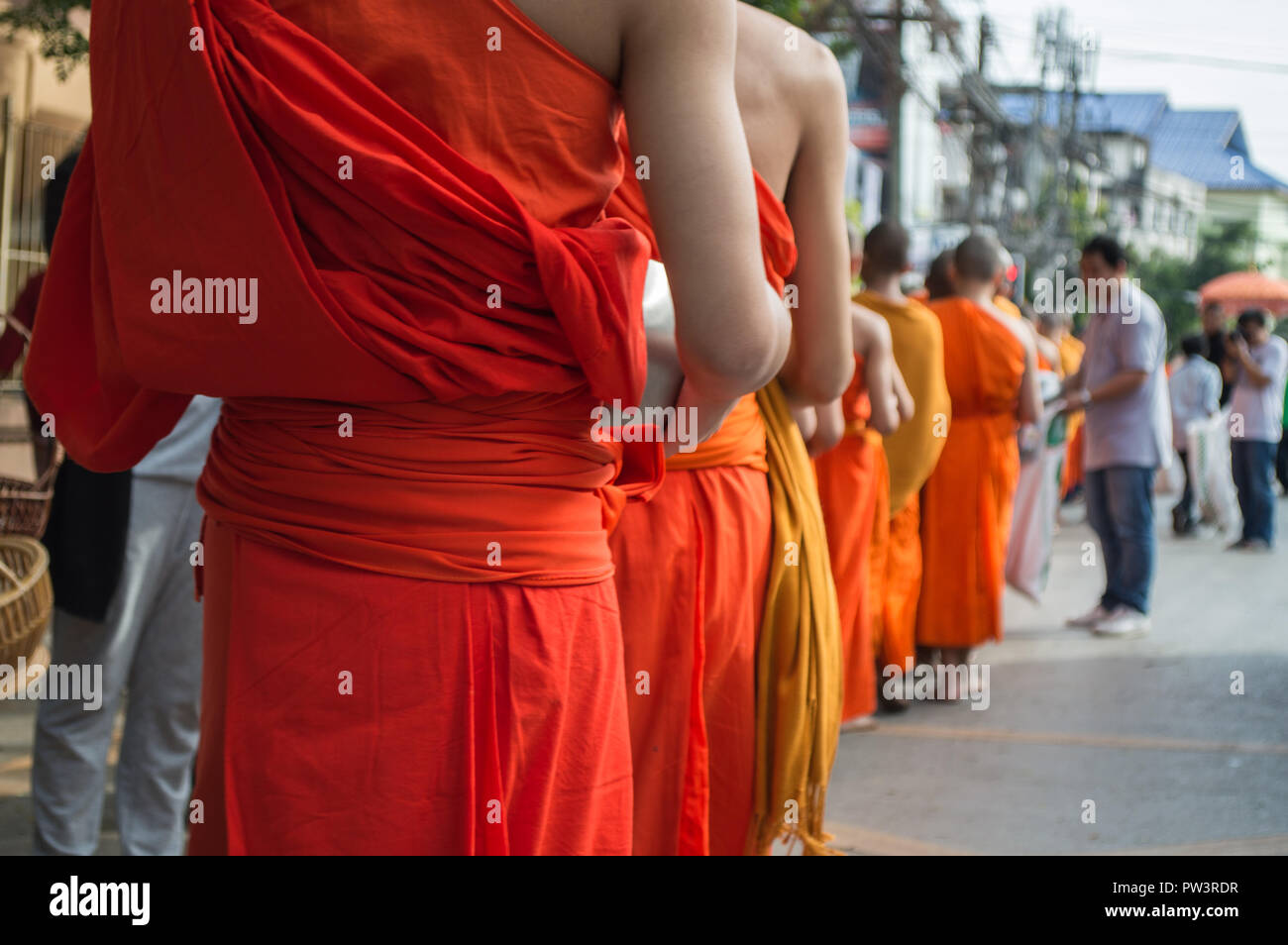 Monks Alms-round or receive food offerings moment. - Stock Image